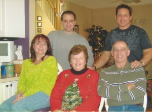 Mama Flasch's family posing for a holiday photo.