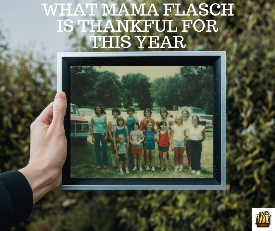 Hand holding a picture frame with an old family photo in it and words What Mama Flasch Is Thankful for this Year