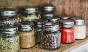 Spice jars filled with spices and herbs.